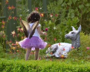 "Fawn statue at Glenveagh Castle being visited by a ""fairy."""